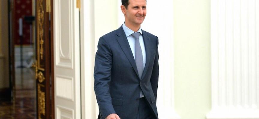 Assad overgiver sig efter aggressivt fakkeloptog